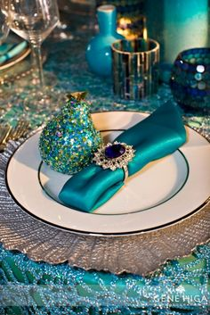 Jewel tones, turquoise, elegant wedding table setting. I like the use of a large cocktail ring as a  napkin ring.