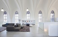 This 1870 Gothic Church in Utrecht, NL was transformed into a contemporary home by Zecc Architects and Thomas Haukes in 2009.