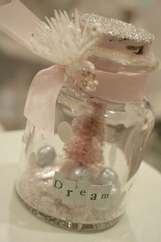DIY Christmas mason jars I want to make these for my girls this year. Need a trip to a craft store. Glitter, jars, lil tree, faux snow and little accidents. Use words from book cut out or print Noel Christmas, Pink Christmas, All Things Christmas, Vintage Christmas, Christmas Ornaments, Beautiful Christmas, Xmas, Peanuts Christmas, Bottle Brush Trees