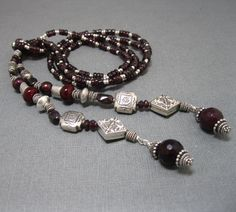Claudia's Lariat in Garnet and Silver, Handcrafted Gemstone Lariat, Artisan Jewelry, Garnet Necklace. $165.00, via Etsy.