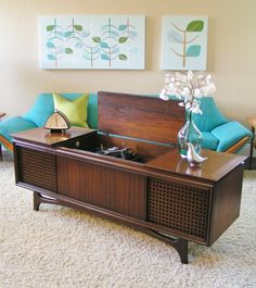 This is a vintage 1964 G.E. Solid State Console Stereo with a transistor (tubeless) Amplifier in an all wood console.