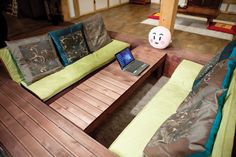 How amazing is this idea?  Couch and coffee table built into the ground!
