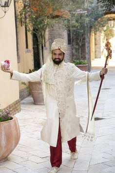 Love the happiness and excitement of this groom dressed in traditional Indian wedding attire.