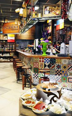 Encaustic cement tiles beautifully used on the face of this bar