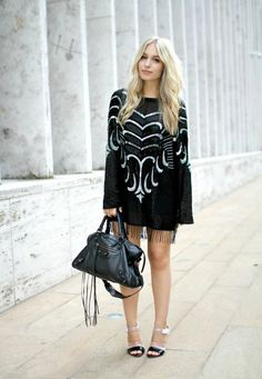 Gorgeous white and black dress teamed with a Balenciaga bag of course...!