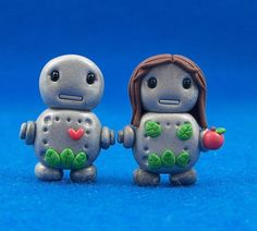 wedding cake toppers for...modest robots? Can robots even be naked? Is that an apple? Are these Robot Adam and Eve? What the crap is going on here?