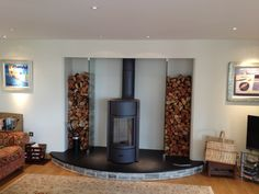 The Stuv 30 installed into a bespoke fireplace by Kernow Fires in Cornwall.   #stuv #freestanding #woodburner #stove #bespoke #fireplace #hearth #glass #logs #store #modern #contemporary #kernowfires #wadebridge #redruth #cornwall