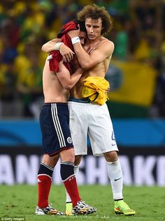 David Luiz of Brazil consoles James Rodriguez of Colombia after Brazil s  win during the 2014 FIFA World Cup Brazil Quarter Final match between Brazil  and ... 6f63fa083e70f