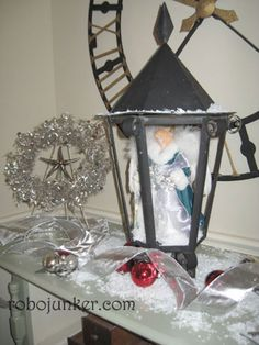 Old Lamps:  Instead of placing a candle in the center, place dried flowers or substitute junk objects instead of plants. Think outside the box as to what you could put inside an old lantern.  Can be reused at Christmas time for a beautiful display case.