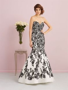 This gown is jaw-dropping in black and white — a perfect for the bride with a flair for chic drama.