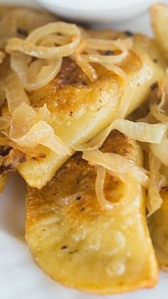 Potato ___ pinned because this recipe tells how to cook a pierogi - refer to & in the instructions These homemade pierogies are made with a potato and cheese filling and dough that's a dream to work with. Saute in butter and serve with caramelized onions! Pierogies Homemade, Homemade Pasta, Homemade Baby, Potato And Cheese Pierogi Recipe, Potato Recipes, Mini Quiches, Ukrainian Recipes, Slovak Recipes, Good Food