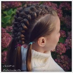 Big Dutch braids and ponytails.