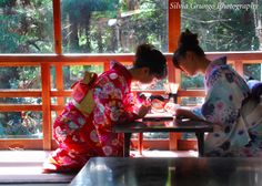 Two young girls in a traditional restaurant inside Fushimi Inari Shrine, Kyoto