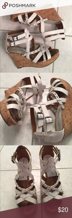 White wedge sandals These wedge sandals are white and scrappy. There are two adjustable straps around the ankle. The heel height is about 4 inches Marc Fisher Shoes Wedges