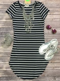 The On the Horizon Tunic Dress in Black is striped, fitted, and oh so fabulous! A great basic that can be dressed up or down!  (www.privityboutique.com)  #stripes #blackandwhite #stretchy #fitted #adorable #essential #basic
