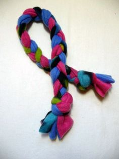 Using just a few fleece scraps and basic braiding, you can whip up a tug-of-war rope toy for your puppy in minutes!