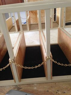 Tie stalls complete with rubber mats dn golden chains.