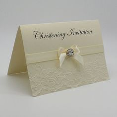 The ChantillyCollection  Hand crafted Unique Lacey Christening / Baby Naming Ceremony Invitation A6 opening card with horizontal fold 300gsm quality card 120gsm paper insert 100gsm envelope included Pretty unique flowered lace overlaid by quality satin ribbon and a choice of embellishments to compliment thisdesign Personalised with your own wording FREE UK POSTAGE ON MOST ITEMS AVAILABLE FROM www.vintagelaceweddingcards.co.uk