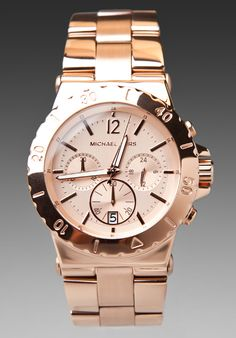 I wear this ALL the time - Michael Kors Rose Gold Chronograph - it goes with EVERYTHING!