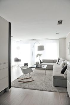 grey rocking chair lamps lighting sofa white carpet
