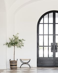 Big arched doors and checkered marble floors. 🙌🏼 Currently headed to Atlanta market and I can't wait to be overloaded with inspiration! This is one of my favorite pics from our project! You can shop the decor 📷: Interior Modern, Home Interior, Interior And Exterior, Interior Decorating, Interior Design, Home Design, Design Homes, Architecture Miami, Potted Olive Tree