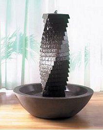 Add a contemporary water feature to your home or garden with the Spiral Tower Pebble Bowl Fountain. Hand crafted by Haddonstone this self-circulating design is perfect for patios and terraces as well as garden rooms and conservatories. Contemporary Water Feature, Portland, Tabletop Water Fountain, Cast Stone, Furniture Styles, Furniture Ideas, Garden Stones, Garden Ornaments, Building Materials