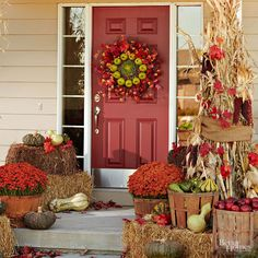 An autumn wreath featuring crisp green apples matches a porch full of fall flowers, gourds, and pumpkins. Hay bales and apple baskets let you play with the heights of your display.