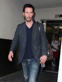 Keanu Reeves arrives at the LAX Airport in Los Angeles, California on August 10, 2012 after a flight into town
