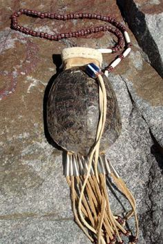 A cool pouch made from a painted turtle shell.