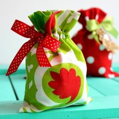 Reduce waste this holiday season by stitching up stylish reusable gift bags. Tutorial for bags in 3 sizes.
