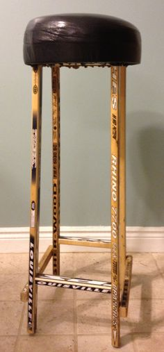 Broken hockey stick stool, would be awesome in a basement bar/ man cave.