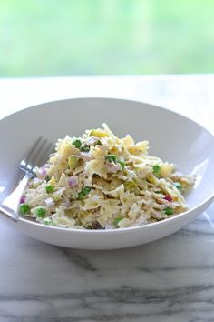 Combine bowtie pasta with tuna, peas, onions, and dill for the ultimate al fresco appetizer.