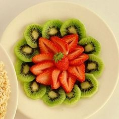 Last summer strawberries with fresh kiwi fruits. A nice kid snack or sides.