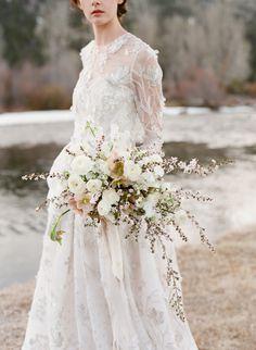 Long sleeve winter bride wedding look: http://www.stylemepretty.com/2016/12/15/best-wedding-dresses-of-2016/ Photography: Jose Villa - http://josevilla.com/