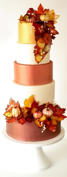 The perfect wedding cake design for the fall featuring warm oranges, reds, golds…