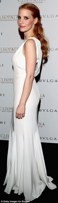 If it ain't broke: Jessica Chastain takes the plunge in a low-cut white gown…