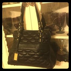 Beautiful Scalloped Leather Badgley Mischka Ariel Beautiful Scalloped Leather Badgley Mischka bag in black. The leather is buttery soft and gorgeous. Bag is in very good pre-owned condition. Clean inside and out. Retails for 485.00. Badgleys are wonderful, quality bags. Badgley Mischka Bags Shoulder Bags