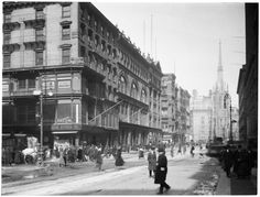 Broadway Series. West side of Broadway. Looking north from 8th Street. #759 on corner - United Cigar Store. Grace Church shows in distance. Date: March 9, 1920
