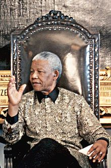"""A Madiba shirt is a batik silk shirt, usually adorned in a bright and colourful print. It has become a well-known nickname for batik shirts in South Africa, being popularised by former South African president Nelson Mandela. It is named after Mandela's clan name """"Madiba"""", an honorary title adopted by all members of his clan."""