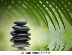 Zen stones - Grean bamboo leaves over zen stones pyramid...