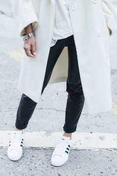 classic adidas shoes with oversize coat.