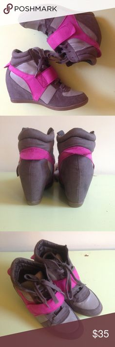 NWT Lane Bryant 9W wedge sneakers Vibrant fuchsia and gray wedge sneakers. Large fuchsia band velcros across the front. All manmade materials. Never worn. There are a few inconsequential scuffs on the edges of the sole and one side from trying on. Lane Bryant Shoes Wedges