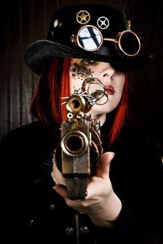 Redhead steam punk gorgeous babe with a gun