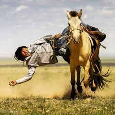 """""""Photo by @irablockphoto (Ira Block)  A rider competes to pick up the most objects on a galloping horse at a Mongolian Naadam festival. This festival was…"""""""