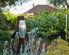 Request a Tesla charger — Airbnb Tesla Charging Stations, Ev Charger, Electric Cars, Ecology, Around The Worlds, Vacation, Outdoor Decor, Plants, Cabin Interiors