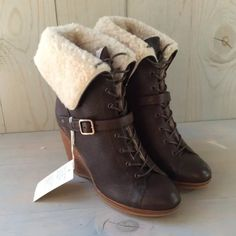 New Ugg Wedges Boots New in box 100% authentic UGG Collection brown wedge boots size 10.                                  Features:                                                                  PEBBLED LEATHER UPPER BUCKLE DETAIL  WAXED LACING GENUINE SHEEPSKIN LINING 4 INCH WOOD HEEL PLATFORM HEIGHT .75 INCHES SHAFT HEIGHT APPROX 8 INCHES WHEN EXTENDED UGG Shoes Ankle Boots & Booties