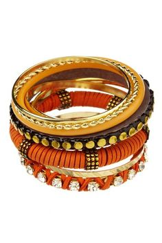 "Gold plated, crystal accented, and wooden multi-textured assorted bangles with leather wrapped detail  - Set of 9  - Fits 6-7.75"" wrists  - Approx. 2 7/8"" standing diameter, 3-8mm widths  - Imported"