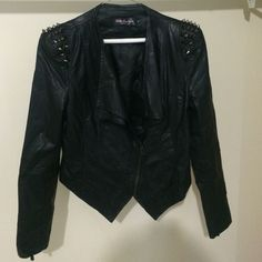 Celeb Boutique Black Leatherette Spiked Jacket Gently worn in great condition Celeb Boutique Black Leatherette silver spiked studded shoulder pad Jacket in XL. It also has a zip to zip up front & zips on the sleeves. This is a snug fit type jacket. Celeb Boutique Jackets & Coats Blazers