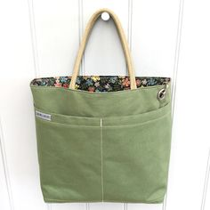 Gardeners bag - green canvas, double pocket, Liberty Tana Lawn lining. Label saying 'Sow seeds - save bees'.
