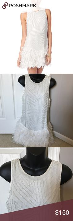 Parker Allegra Sequin Feather Dress Aaaaaamazing Parker Allegra dress. Awesome beading detailing with Feather skirt. Worn once, I recommend dry cleaning. Small dusting of bronzer on neck line, but has not been cleaned yet, rubs out during spot cleaning. Be the star of the party or the most glamorous bride at your bachelorette party. Size small. No trades. Free shipping on merc. Parker Dresses Mini
